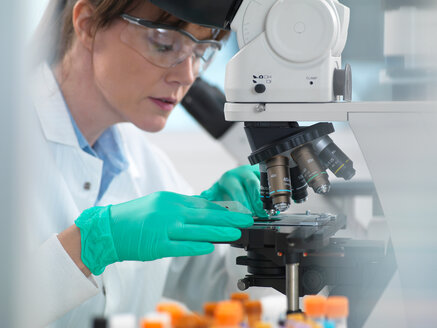 Medical testing of variety of human samples including blood and tissue under microscope in laboratory - ISF21352