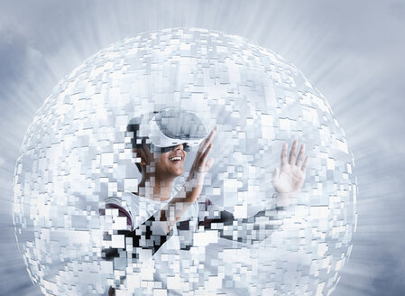 Fiji Indian boy wearing virtual reality goggles in floating sphere - BLEF03093