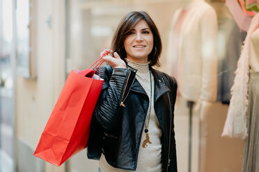 Stylish female shopper in front of fashion boutique - CUF51110