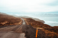Road leading towards mountains, Eskifjörður, Sudur-Mulasysla, Iceland - CUF51251