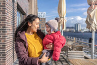 Mother and daughter by river, Berlin, Germany - CUF51272