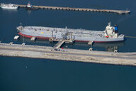Aerial view of oil tanker moored at commercial dock - JUIF00924