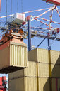 Crane lifting cargo container at commercial dock - JUIF01002