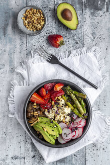Veggie bowl with quinoa, vegetables, feta, strawberries, avocado, pine nuts and cress - SARF04254