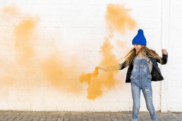 Smiling girl with orange smoke torch - ERRF01276