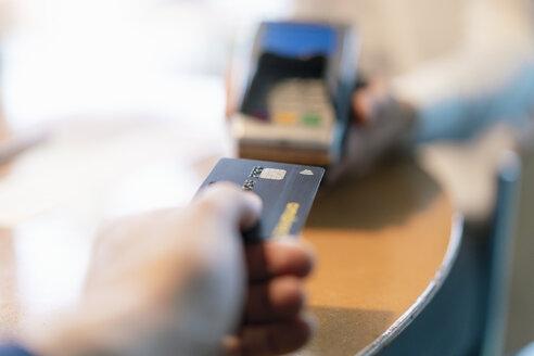 Man using credit card reader, close-up - DIGF07022