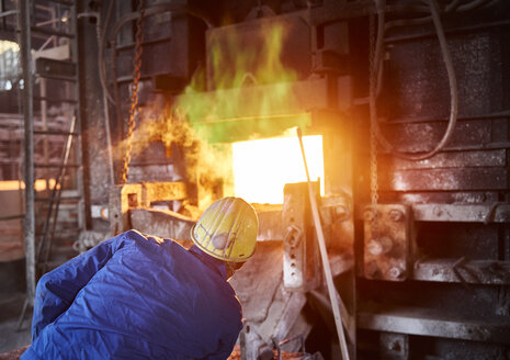 Industry, Smeltery: Worker checking blast furnace for fractures - CVF01194