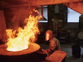 Industry, worker at furnace during melting copper, wearing a fire proximity suit - CVF01199