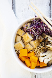Miso Ramen soup with noodles, hokaido pumpkin, red radish sprouts, fried tofu, shimeji mushroom and king trumpet mushroom - LVF08023
