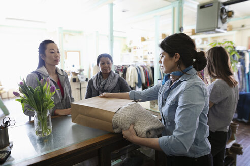 Women shopping and working in vintage clothing shop - HEROF36293