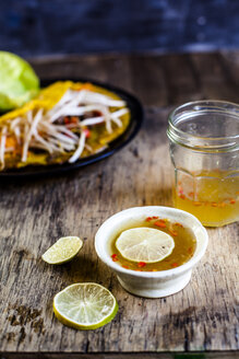 Banh xeo with lettuce and Nuoc Cham dipping sauce - SBDF03957
