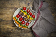 Grilled vegetable skewers on a plate - LVF08029