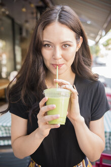 Thai woman drinking green smoothie - BLEF03401
