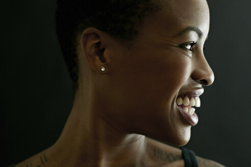 Profile of smiling Black woman - BLEF03503