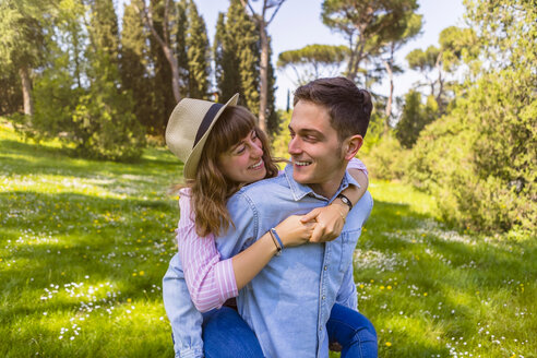 Romantic couple having fun in a park, Tuscany, Italy - MGIF00432