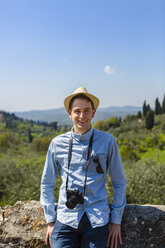 Young man standing at wall in Florence, Tuscany, Italy - MGIF00438
