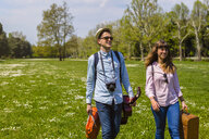 Young couple having a picnic  in a park - MGIF00450