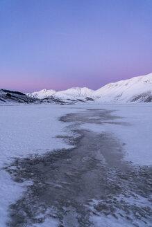 Italy, Umbria, Piano Grande of Castelluccio di Norcia plateau and Vettore in Winter - LOMF00862