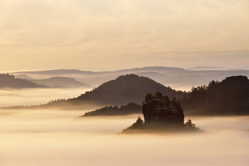 Germany, Saxony, Elbe Sandstone Mountains, view to the mountain Winterstein from the Gleitmannshorn at sunrise - RUEF02205