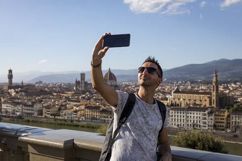 Man taking a selfie, Florence, Italy - MAUF02453