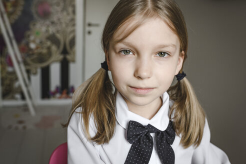 Portrait of a girl wearing bow and shirt - EYAF00240