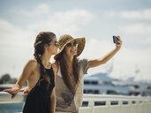 Caucasian women posing for cell phone selfie - BLEF03681