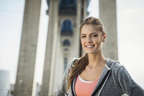 Smiling Caucasian woman posing under overpass - BLEF03687