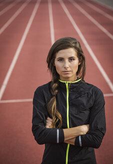 Caucasian woman posing on running track - BLEF03693