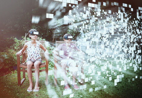 Mixed Race brother and sister viewing hovering pixels with vr goggles - BLEF03717