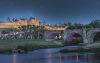 Stars at night over fortified city of Carcassonne, Languedoc-Roussillon, France - BLEF03738