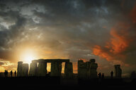 Silhouette of people during sunset at Stonehenge, England, United Kingdom - BLEF03750