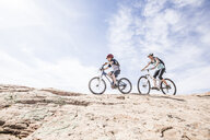 Caucasian mother and son riding mountain bikes - BLEF03828