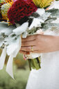 Close up of bride wearing wedding rings - BLEF03885