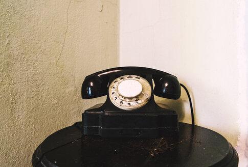 Retro landline telephone on table in corner - BLEF04074