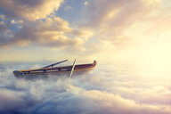 Empty rowboat above clouds - BLEF04095