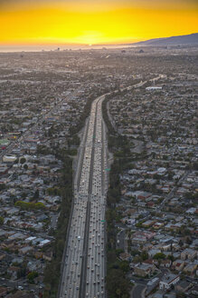 Aerial view of highway in suburban cityscape - BLEF04104