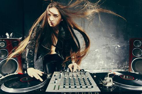 Disc jockey playing music in nightclub - BLEF04122