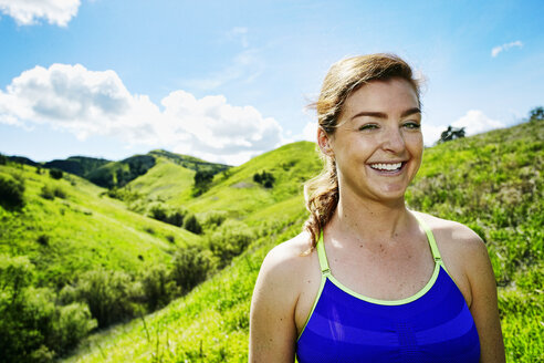 Smiling Caucasian woman posing on hill - BLEF04287