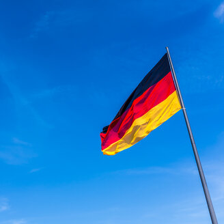 German flag against blue sky - MHF00508