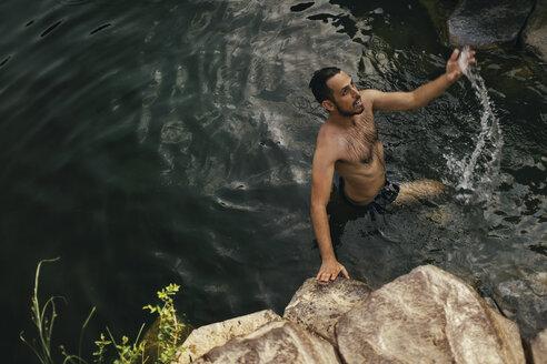 Man in the water, Yehudiya Reserve, Golan, Israel - GCF00252