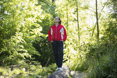 Female mature jogger in the forest - FLLF00213