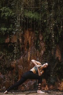 Woman practicing yoga in nature - LJF00007