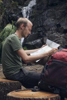 Hiker taking a break at rest area, Barranco el Cedro, La Gomera, Canary Islands, Spain - MAMF00682