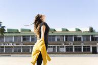 Happy teenage girl standing outdoors - ERRF01403