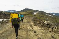 Hikers walking on mountain path in winter - BLEF04426