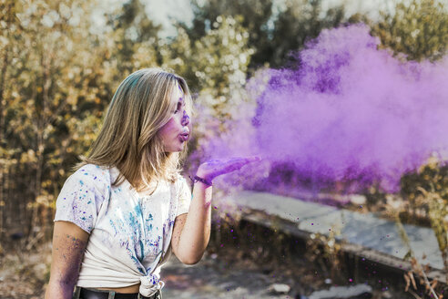 Girl blowing Holi powder colours, Germany - VGPF00029