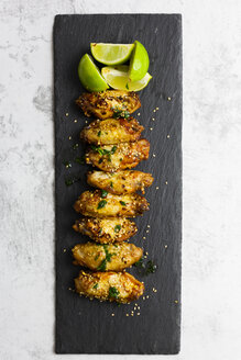 Spicy chicken wings with lime on slate - GIOF06383