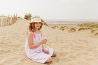Portrait of girl sitting on the beach having a drink - NMS00308