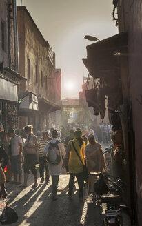 Crowd walking in street, Jamaa el Fna Square, Marrakesh, Morocco, - BLEF04688