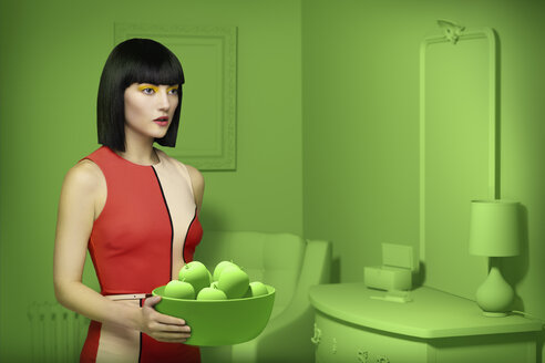 Caucasian woman in green old-fashioned bedroom carrying bowl of apples - BLEF04763
